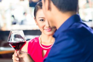 Chinese couple with wine